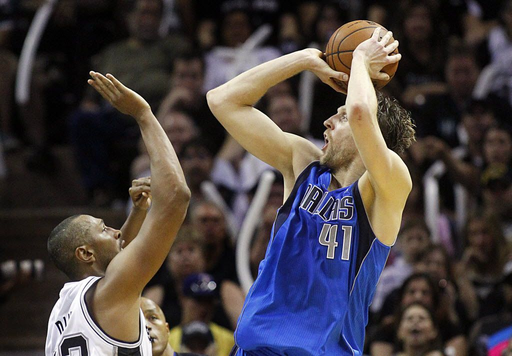 Dallas Mavericks forward Dirk Nowitzki (41) puts up a jumper over San Antonio Spurs forward Boris Diaw (33) in the second half of the NBA Western Conference Quarterfinals Game 7 at the AT&T Center in San Antonio, Texas, Sunday, May 4, 2014.