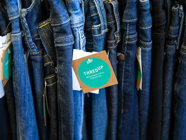 Jeans sit on the shelves in the thredUP section at J.C. Penney.