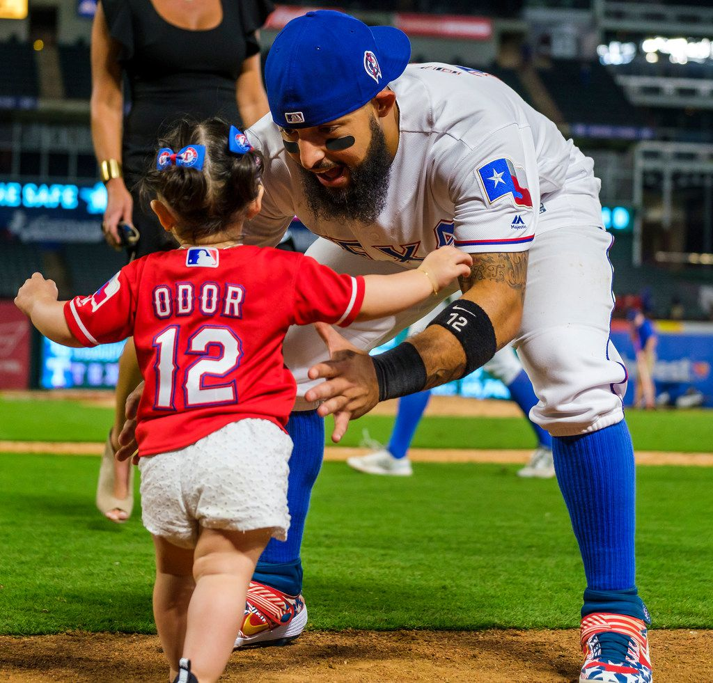 Texas Rangers second baseman Rougned Odor picks up his daughter Emma after the Rangers 10-9 victory over the Tampa Bay Rays at Globe Life Park on Wednesday, Sept. 11, 2019, in Arlington. (Smiley N. Pool/The Dallas Morning News)