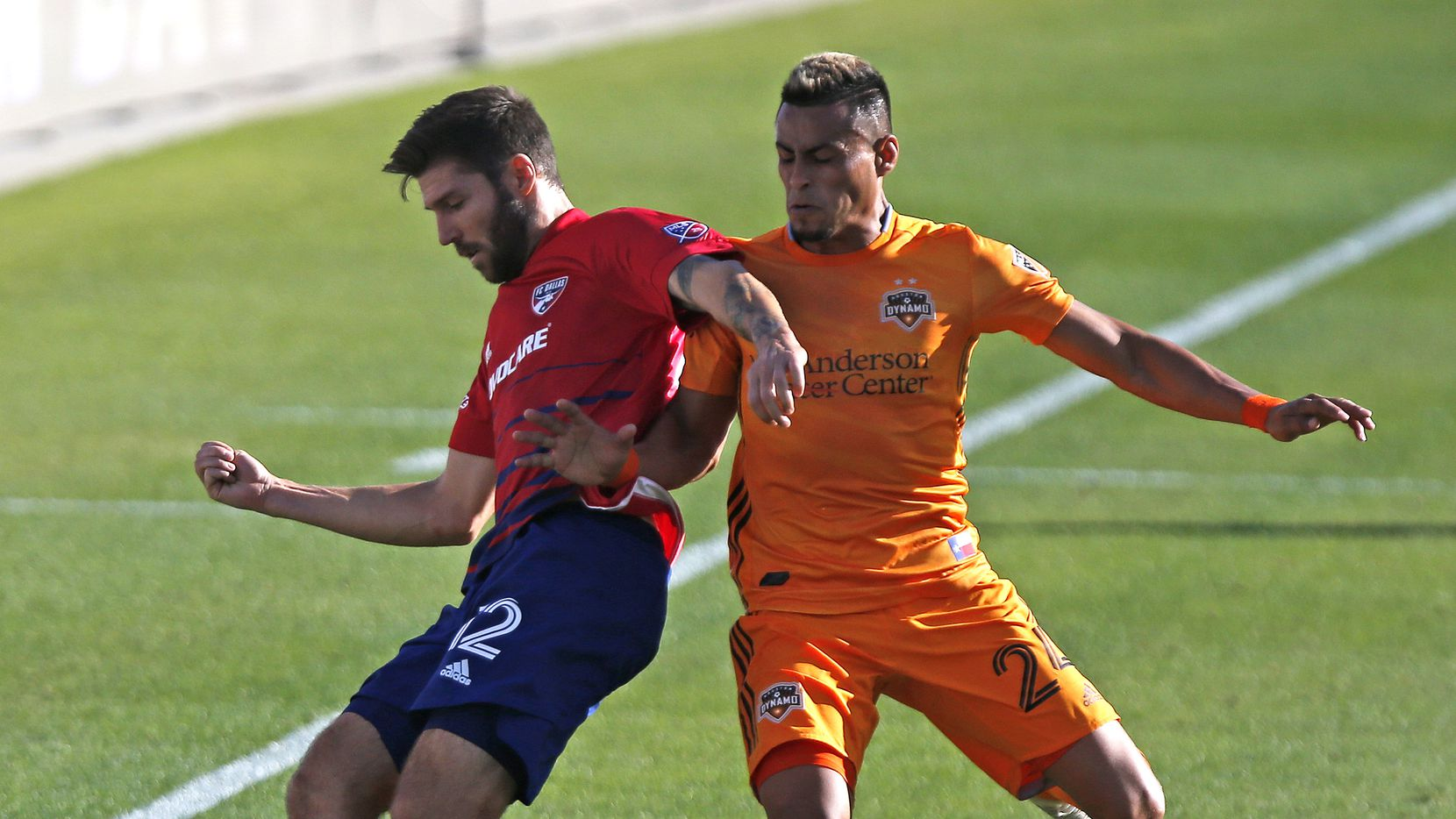 FC Dallas' Ryan Hollingshead (12) stops the ball as Houston Dynamo midfielder Darwin Ceren (24) defends during the second half as FC Dallas hosted the Houston Dynamo at Toyota Stadium in Frisco on Saturday afternoon, October 31, 2020.