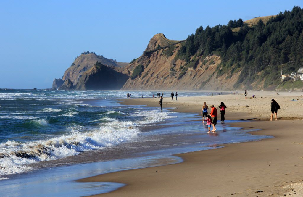 This May 2010 photo shows people on a stretch of beach in Lincoln City, Ore. As of 2014, there are about 500 vacation rental homes sprinkled throughout the residential zones, and the city has started to discuss whether it's time to regulate their growth. (AP Photo/Statesman Journal, Zach Urness) 06082014xBIZ 06142015xTRAVEL
