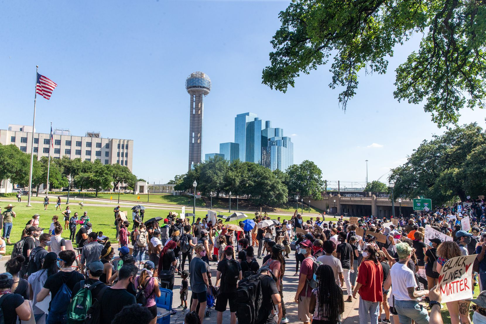 Protesters assemble at the grassy knoll on June 3 during a demonstration denouncing police brutality and systemic racism. The gathering was organized by Not My Son, a new organization in Dallas.