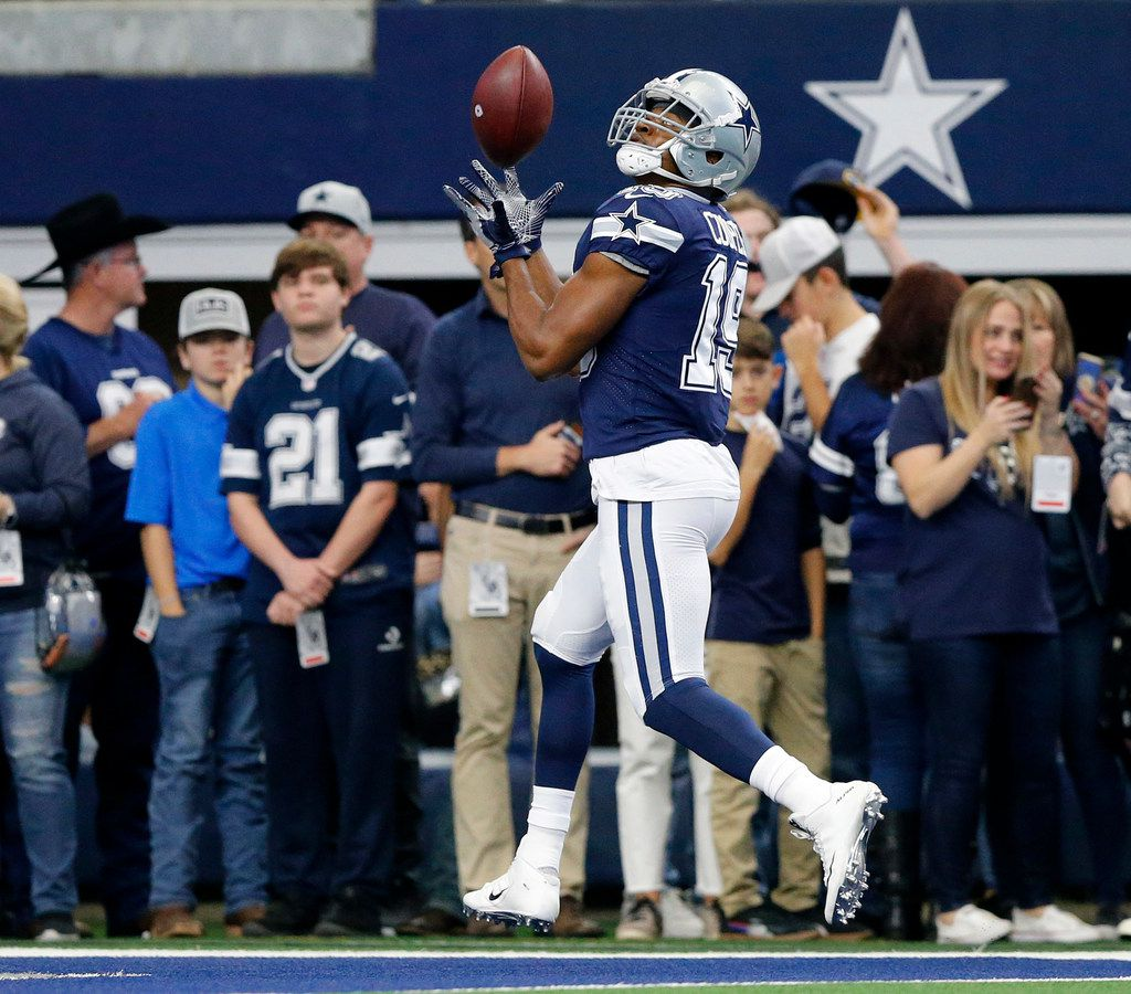 FILE - Cowboys wide receiver Amari Cooper (19) pulls in a pass in the end zone during pregame warmups at AT&T Stadium in Arlington on Sunday, Dec. 15, 2019.