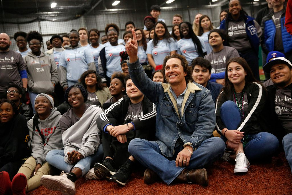 Matthew McConaughey poses for a photo with students from Sam Houston High School, Pinkston High School and Eastern Hills High School during a Rangers Play Ball event hosted by the Just Keep Livin Foundation, founded by McConaughey, and the Texas Rangers Baseball Foundation at the Texas Rangers Youth Academy at the Mercy Street Sports Complex in Dallas on Tuesday, March 5, 2019. (Rose Baca/Staff Photographer)