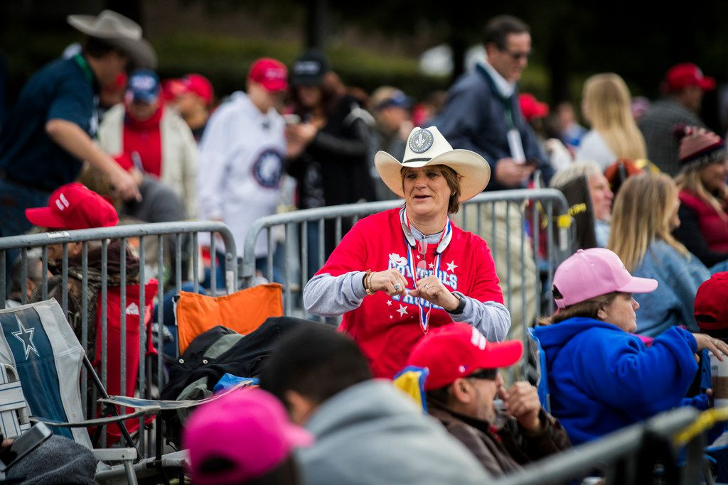 People arrive before a scheduled President Donald Trump rally for Sen. Ted Cruz at the Toyota Center on Monday, Oct. 22, 2018, in Houston. (Marie D. De Jesús/Houston Chronicle via AP)