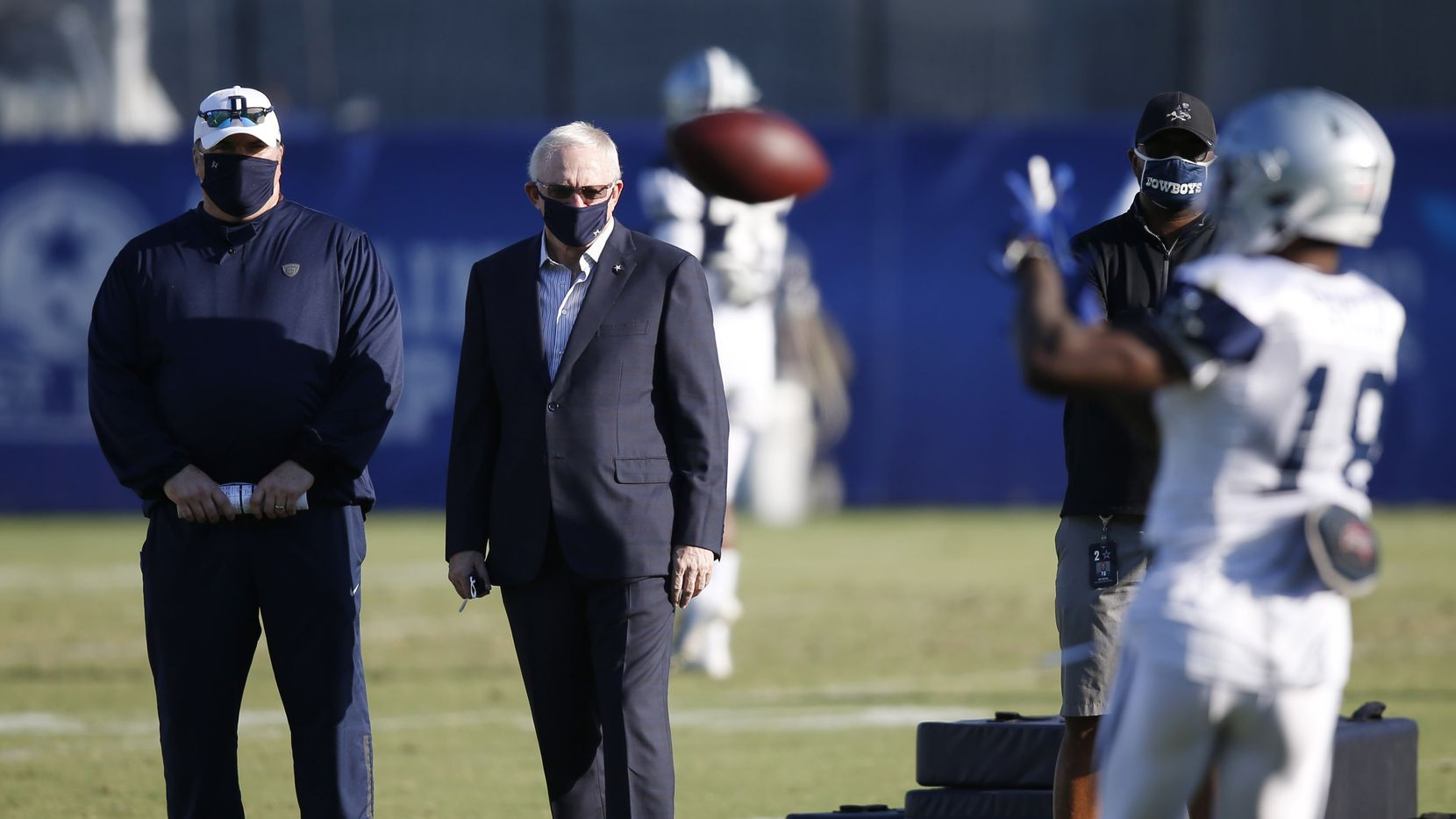 Dallas Cowboys head coach Mike McCarthy and Dallas Cowboys owner and general manager Jerry Jones watch Dallas Cowboys wide receiver Aaron Parker (18) run through drills during training camp at the Dallas Cowboys headquarters at The Star in Frisco, Texas on Friday, August 21, 2020.