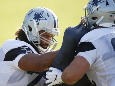 Dallas Cowboys center Joe Looney (73) runs through a drill with Dallas Cowboys center Marcus Henry (62) during the first day of training camp at Dallas Cowboys headquarters at The Star in Frisco, Texas on Friday, August 14, 2020.