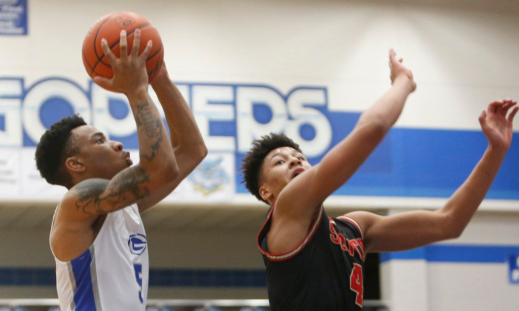 Grand Prairie's Donovan Newton (5) drives to the basket as he is defended by South Grand Prairie's Khaden Bennett (4) during second half action. Grand Prairie won the game, 72-68. The two teams played their boys basketball game at  Grand Prairie High School in Grand Prairie on January 11, 2020.  (Steve Hamm/ Special Contributor)
