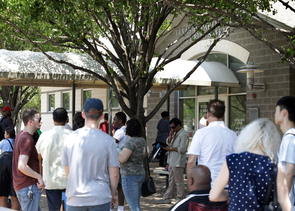 People waited outside in the heat on Aug. 16 at the Texas Department of Public Safety building in McKinney.