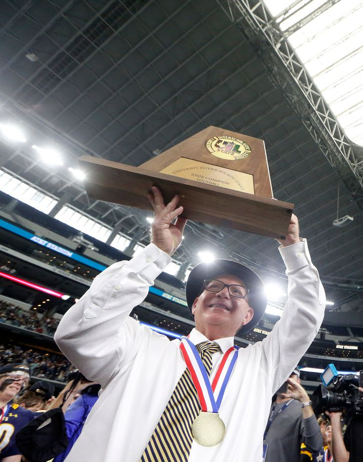 Highland Park's Head coach Randy Allen holds up the Class 5A Division I football state championship trophy after beating Shadow Creek 27-17 at AT&T Stadium in Arlington, Texas on Dec 22, 2018. Highland Park won the game 27-17. (Nathan Hunsinger/The Dallas Morning News)