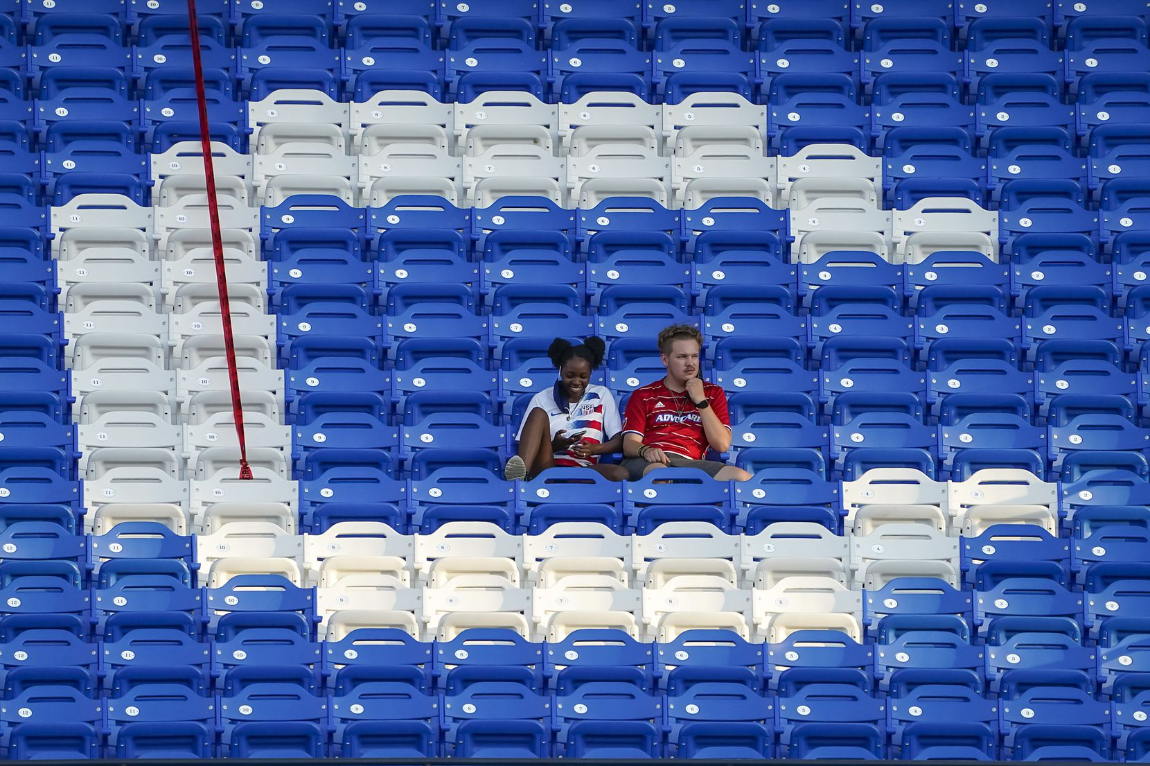 Fans sit in the middle of the ÔCÕ in FC Dallas during the first half of an MLS soccer game against Nashville SC at Toyota Stadium on Wednesday, Aug. 12, 2020, in Frisco, Texas. (Smiley N. Pool/The Dallas Morning News)