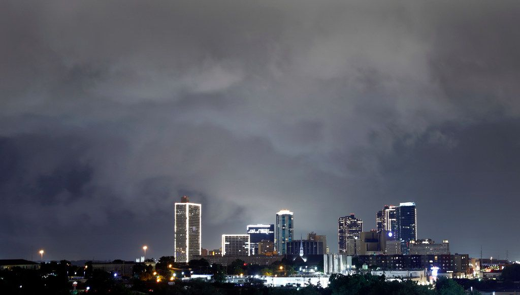 A slow-moving thunderstorm packing 50+ mph winds rolls over downtown Fort Worth, Wednesday night, June 20, 2018. (Tom Fox/The Dallas Morning News)
