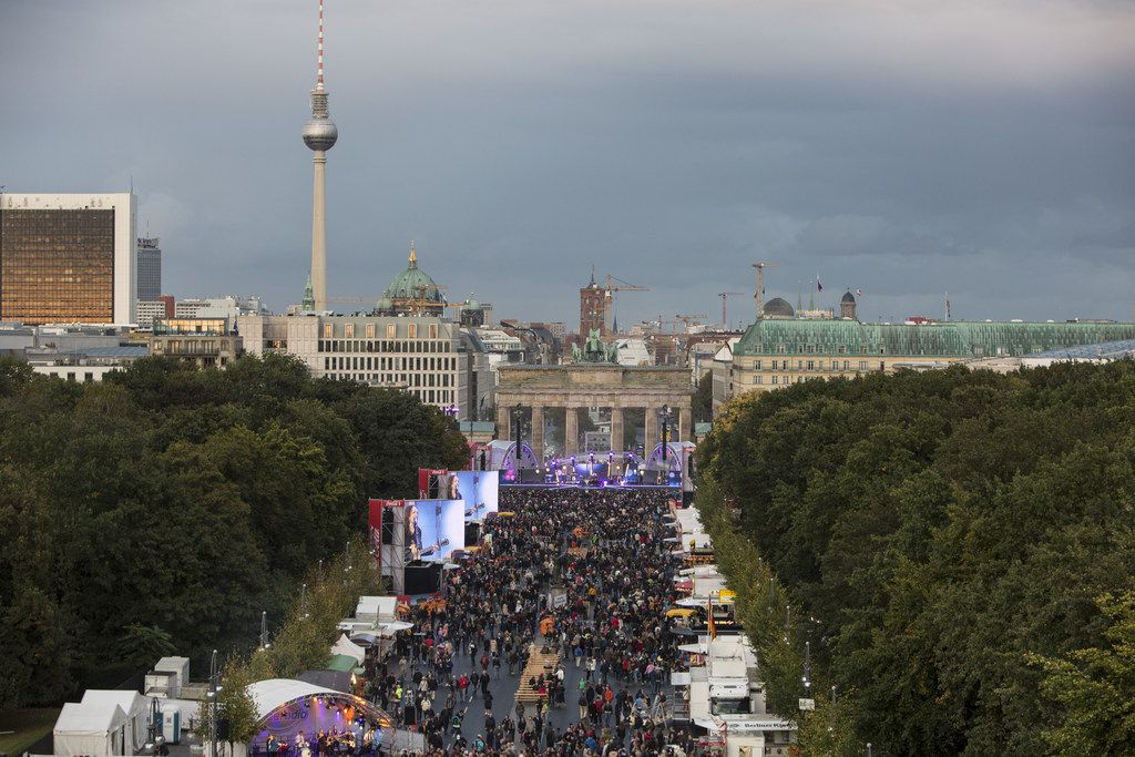 BERLIN, GERMANY - OCTOBER 03: A general view of an amusement area set up along 17th of June Street in Tiergraten Park near the Brandenburg Gate on German Unity Day (Tag der Deutschen Einheit) on October 3, 2017 in Berlin, Germany. Unity Day commemorates the reunification of East and West Germany following the end of the Cold War in 1991. This year Germany is looking somewhat less unified after the right-wing Alternative for Germany (AfD) political party won 12.6% of the vote in federal elections in September, with the strongest turnout occurring in parts of eastern and southern Germany. (Photo by Omer Messinger/Getty Images)