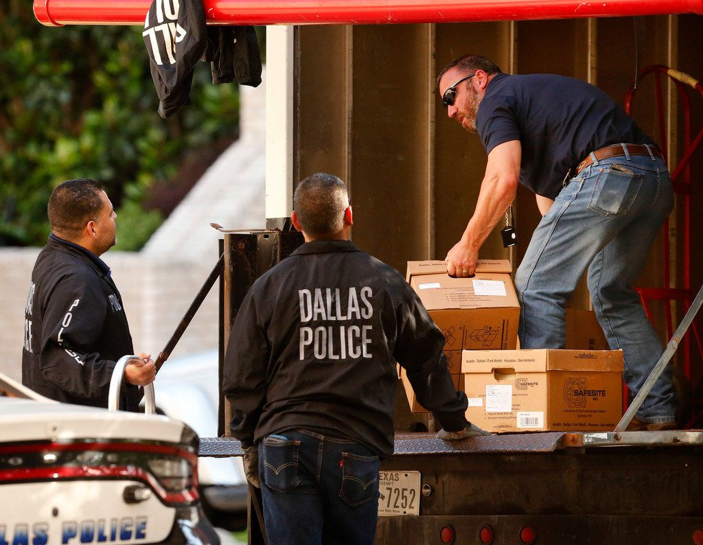 Dallas police officials load out boxes from a raid on the Catholic Diocese of Dallas, Wednesday, May 15, 2019. Dallas police officers on Wednesday morning raided several Dallas Catholic Diocese offices after a detective said church officials have not cooperated with investigations into sexual abuse by its past clergy members. Since a police investigation began last fall, at least five new allegations of sexual abuse have surfaced within the Catholic Diocese, according to Major Max Geron, who oversees the special investigations division. (Tom Fox/The Dallas Morning News)