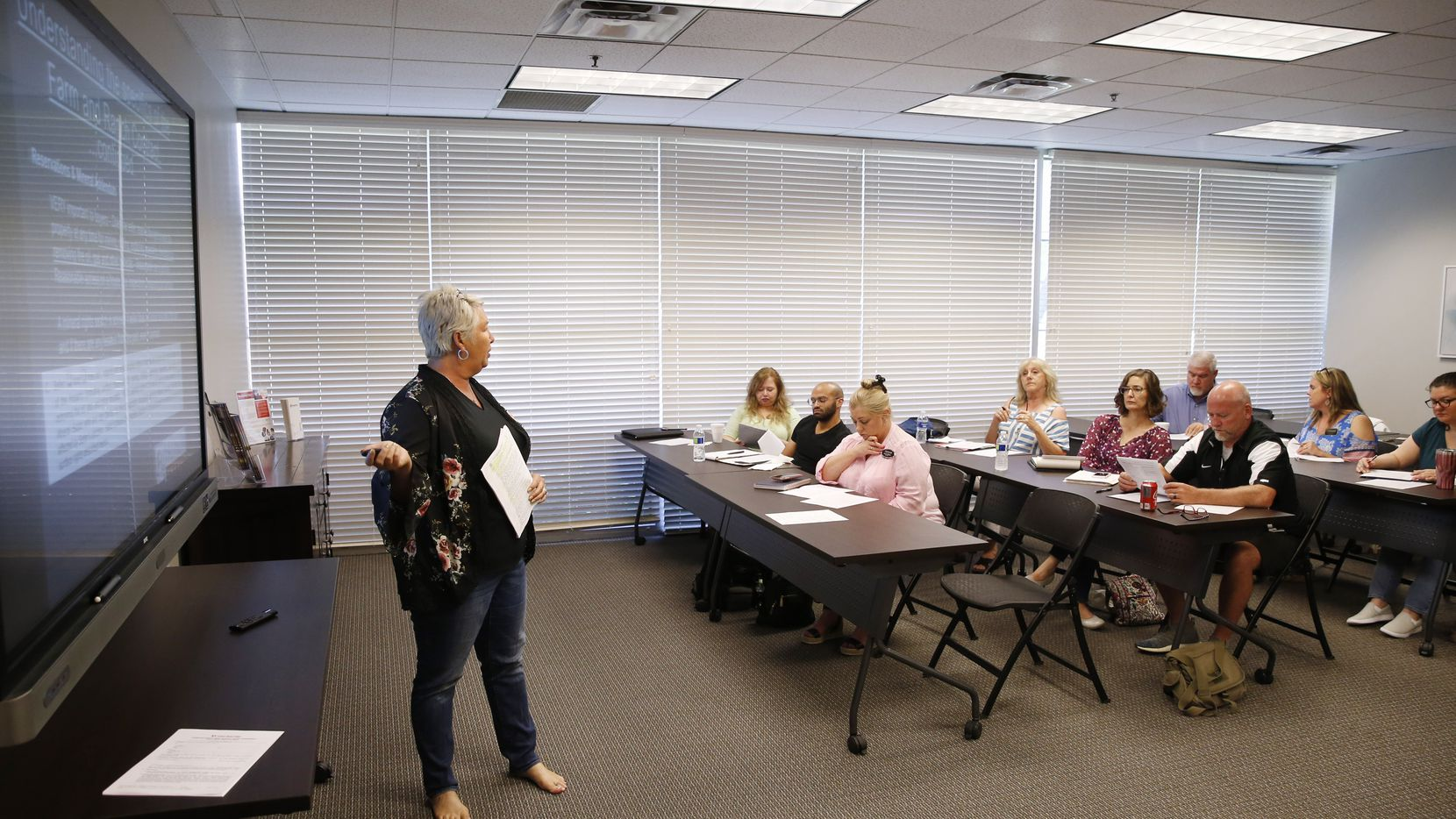 Genevieve Golden leads a farm and ranch contract training session for Fathom Realty agents in Plano.