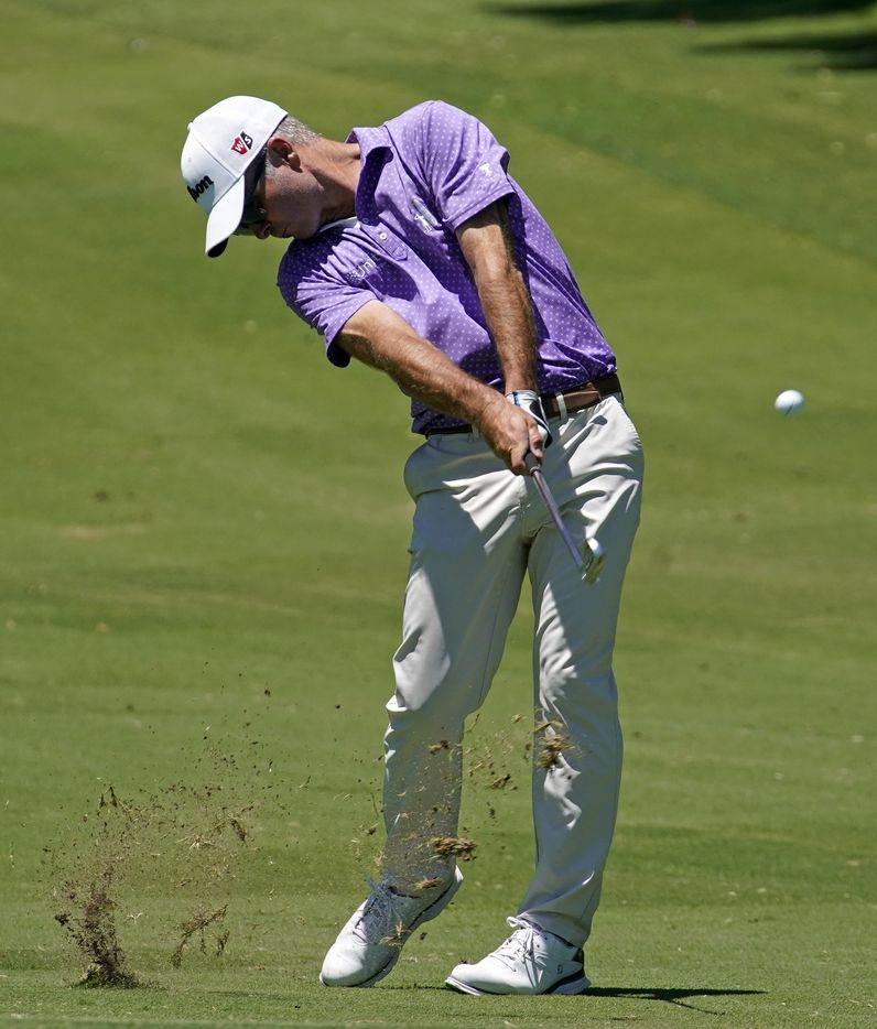 PGA Tour golfer Kevin Streelman makes his approach shot on No. 18 during the opening round of the Charles Schwab Challenge at the Colonial Country Club in Fort Worth, Thursday, June 11, 2020.  The Challenge is the first tour event since the COVID-19 pandemic began. (Tom Fox/The Dallas Morning News)