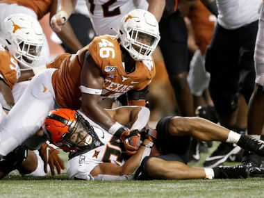 AUSTIN, TX - SEPTEMBER 21:  Chuba Hubbard #30 of the Oklahoma State Cowboys is stopped short on a fourth down by Joseph Ossai #46 of the Texas Longhorns in the second half at Darrell K Royal-Texas Memorial Stadium on September 21, 2019 in Austin, Texas.  (Photo by Tim Warner/Getty Images)