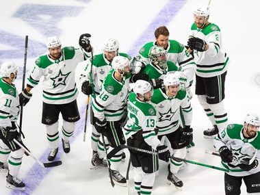 The Stars celebrate Corey Perry's game-winning goal against the Lightning in Game 5 of the Stanley Cup Final at Rogers Place in Edmonton, Alberta, Canada, on Saturday, Sept. 26, 2020.