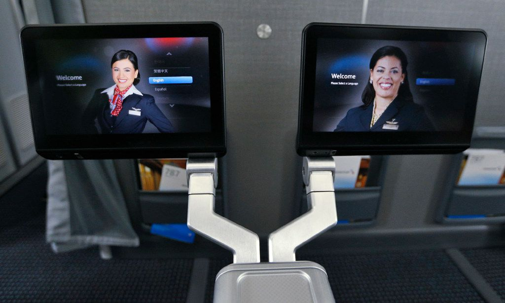 Fold up monitors in the front seats of the new premium economy cabin seating in the American Airlines new 787-9 Dreamliner at DFW Airport on Nov. 3, 2016.  (Nathan Hunsinger/The Dallas Morning News)