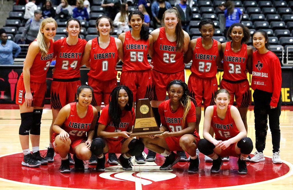 The Frisco Liberty High School basketball team receives their regional championship trophy after the game as Midlothian High School hosted Frisco Liberty High School in the Class 5A Region II championship girls basketball game at the Curtis Culwell Center in Garland on Saturday, February 29, 2020.