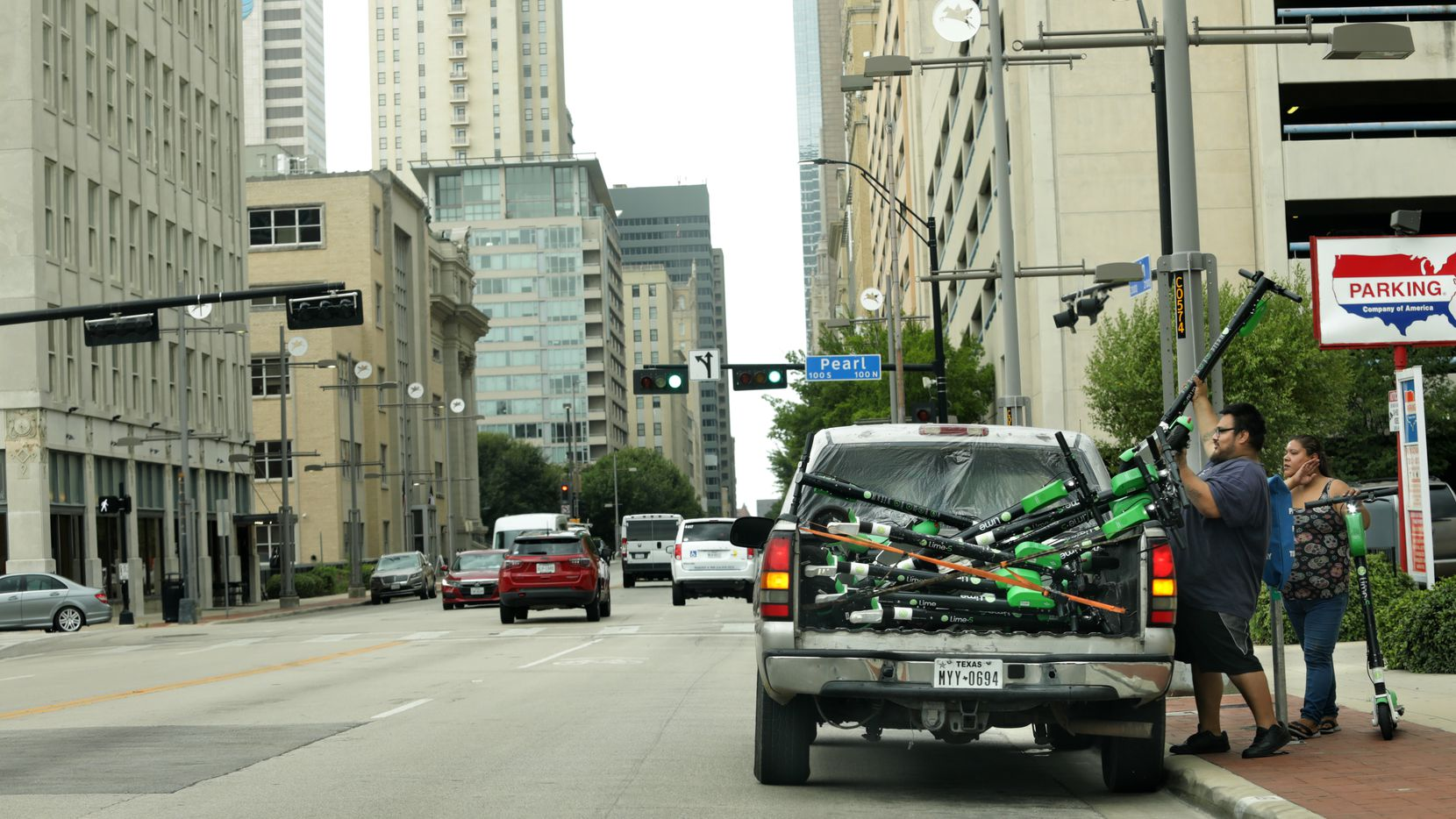 Rental scooters get loaded into a truck in Dallas, Texas, on Sep. 1, 2020. (Jason Janik/Special Contributor)