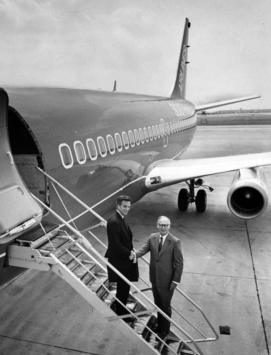 Rollin W. King (left) of San Antonio, executive vice-president of Southwest Airlines, flew the first of the new airline's three Boeing 737 jetliners into Dallas Love Field Friday, June 4, 1971, and was greeted by president M. Lamar Muse at Love Field Air Center.
