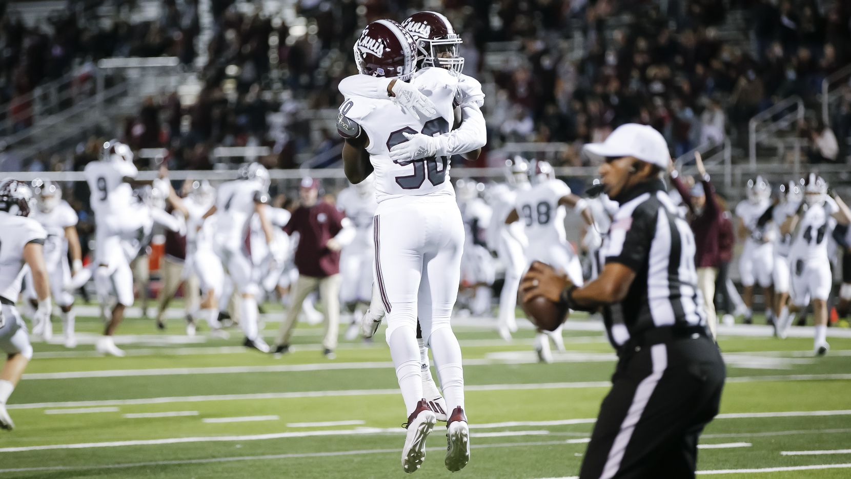Ennis senior defensive lineman Jarveon Williams (90) is congratulated by senior defensive back Stephon Townsend after recovering a fumble by North Forney senior punter Collyn Shipley in the end zone for a touchdown during the first half of a high school playoff football game in Forney, Thursday, November 19, 2020. (Brandon Wade/Special Contributor)