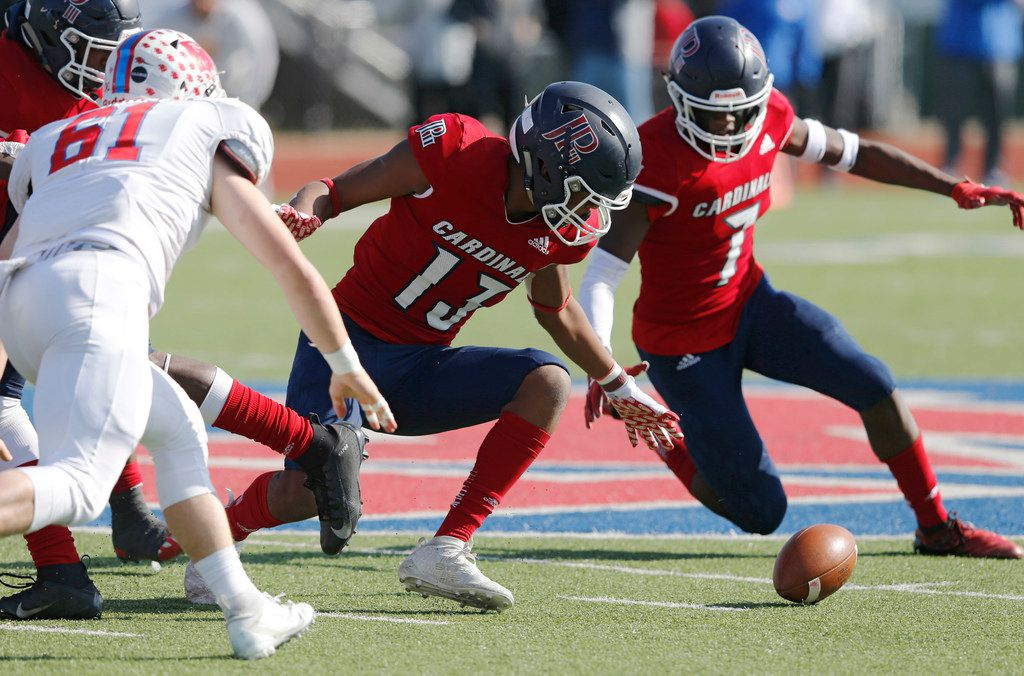 Plano John Paul II's Cam Robertson (13) goes after the loose ball as teammate Charles Daniels III (7) and Parish Episcopal's Jackson Harris (61) close in on the play during the 2019 TAPPS Division I state championship game at Waco Midway's Panther Stadium. (Vernon Bryant/The Dallas Morning News)