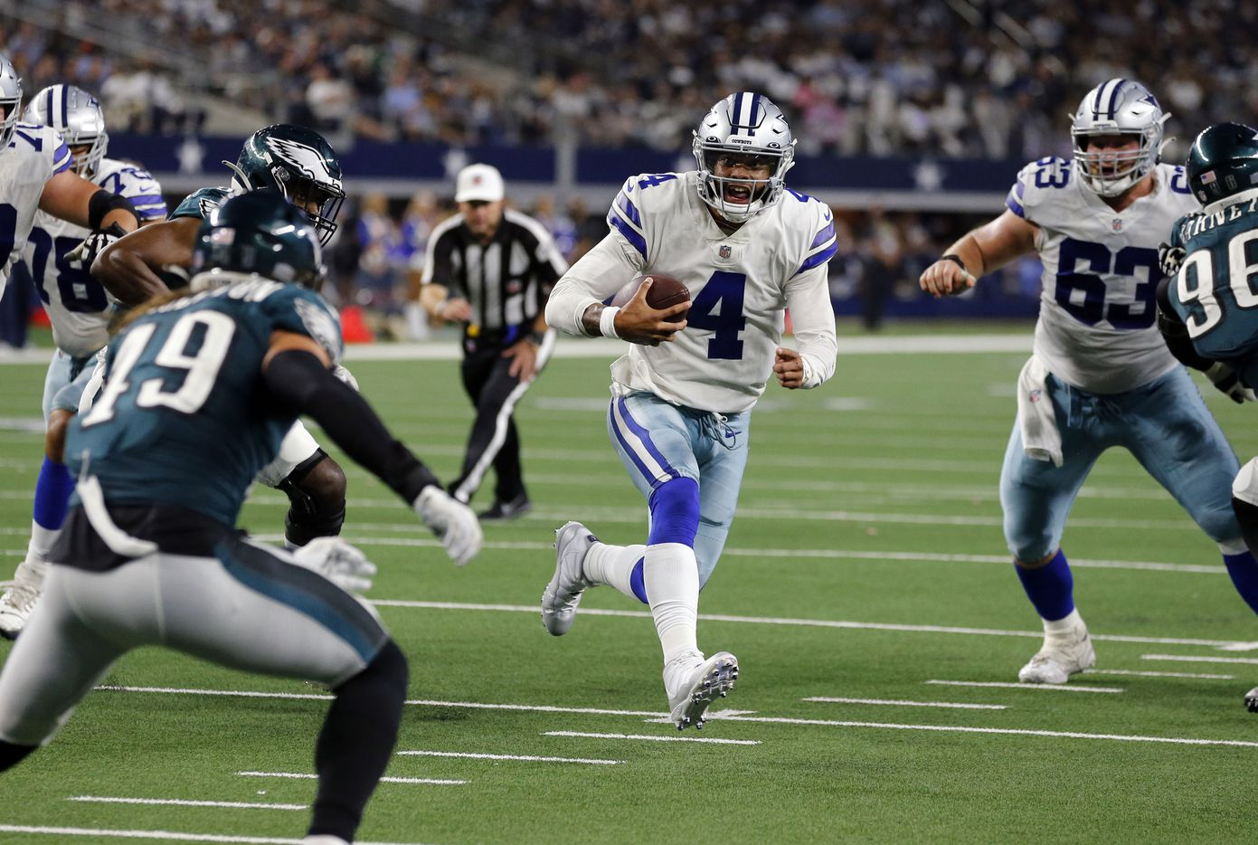 Dallas Cowboys quarterback Dak Prescott (4) scrambles to the two-yard-line during the second half of a NFL football game against the Philadelphia Eagles High at AT&T Stadium in Arlington on Monday, September 27, 2021. (John F. Rhodes / Special Contributor)
