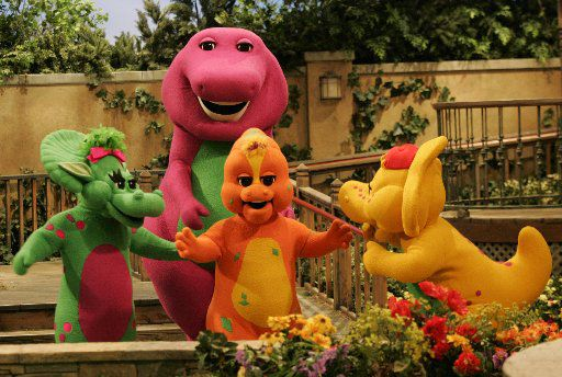 ORG XMIT: *S0417754161* ** ADVANCE FOR WEEKEND SEPT. 9-10 ** Riff, front center, a new character on the Barney & Friends show, is shown with the show's other dinosaur characters Baby Bop, left, Barney, back, and B.J. during the taping of a new Barney episode at the Barney & Friends studio in Carrollton, Texas, Tuesday, Aug. 29, 2006. (AP Photo/Donna McWilliam) DN102