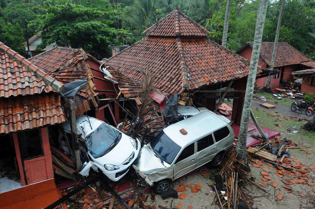 Damaged buildings and cars are seen in Anyer, Serang on December 23, 2018, after the area was hit by a tsunami on December 22 following an eruption of the Anak Krakatoa volcano. - A volcano-triggered tsunami has left at least 222 people dead and hundreds more injured after slamming without warning into beaches around Indonesia's Sunda Strait, officials said on December 23, voicing fears that the toll would rise further. (Photo by Dasril Roszandi / AFP)DASRIL ROSZANDI/AFP/Getty Images
