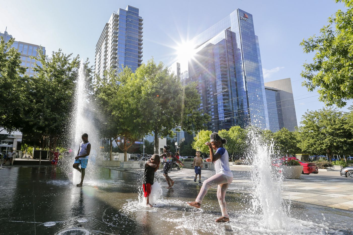 Children enjoy the Moody Plaza water feature at Klyde Warren Park on Wednesday, June 23, 2021, in Dallas.