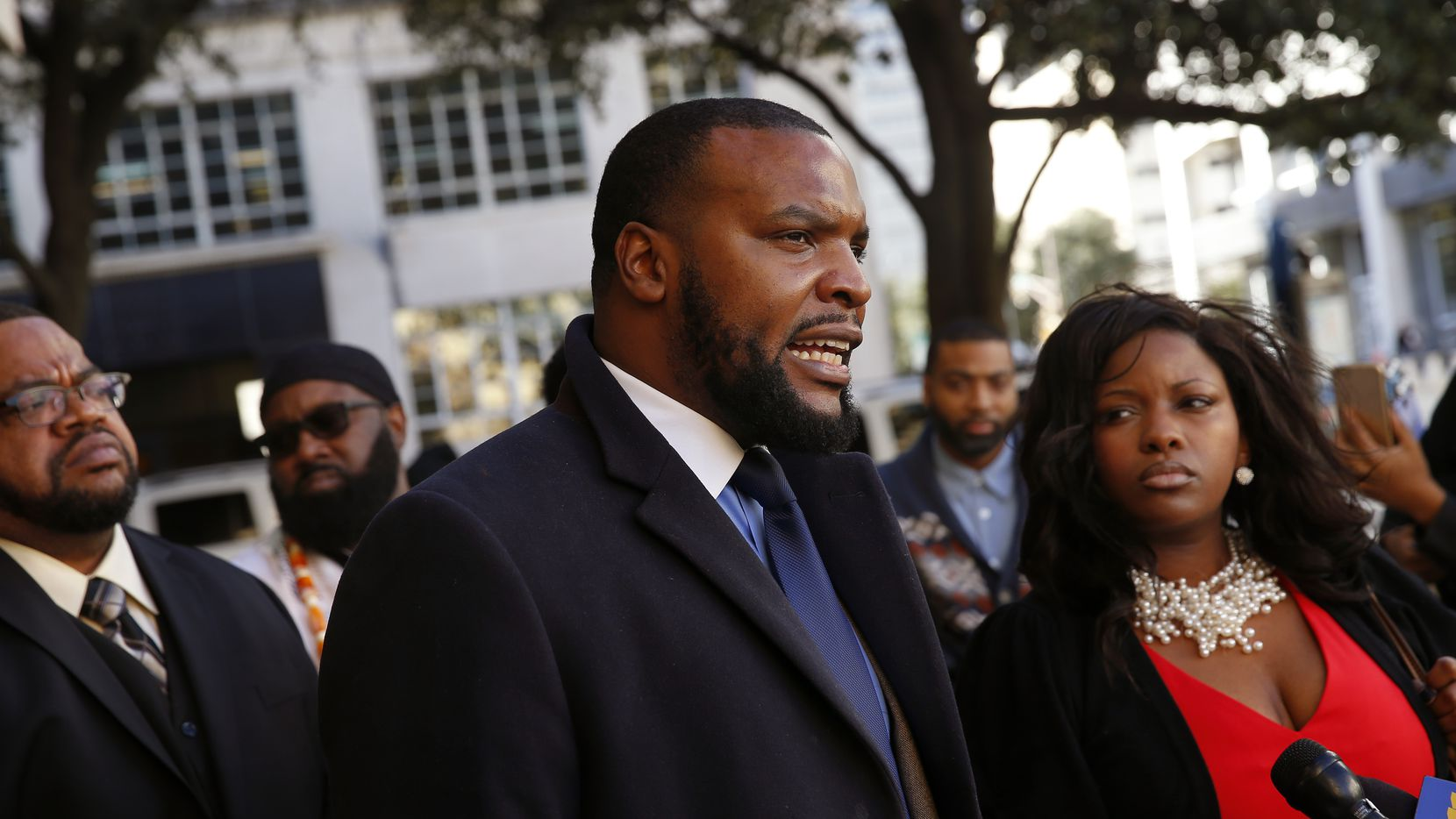 Civil rights lawyer Lee Merritt, shown addressing the news media outside Fort Worth City Hall in 2019, says Attorney General Ken Paxton hasn't done enough to train police or provide mental health services for those in need.