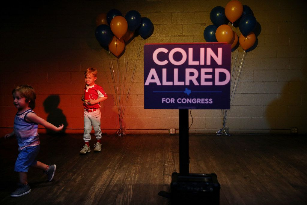 Zayne Robinson (left), 3, and his brother Joshua Robinson, 5, of Dallas, play on stage during an election night party for Colin Allred at Ozone Grill and Bar in Dallas Tuesday May 22, 2018.