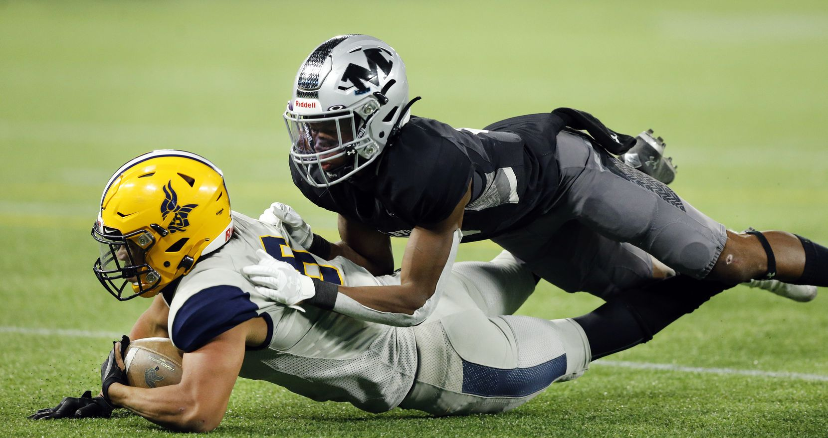 Arlington Lamar running back Anthony Williams (6) is stopped short of the goal line by Arlington Martin's Lenard Lemons (5) to end the first half at Globe Life Park in Arlington, Friday, October 30, 2020.