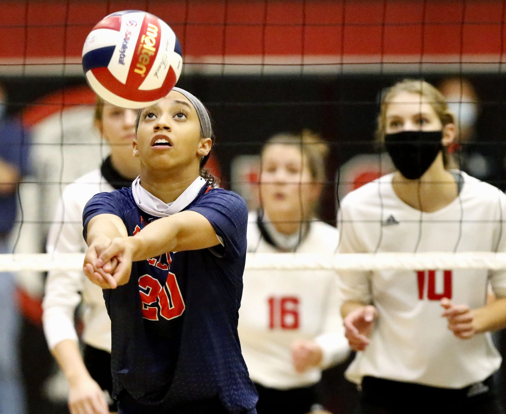 McKinney North High School middle hitter Nylah Encalade (20) passes the volleyball during game one as Lovejoy High School hosted McKinney North High School in Lucas on Tuesday, October 13, 2020.