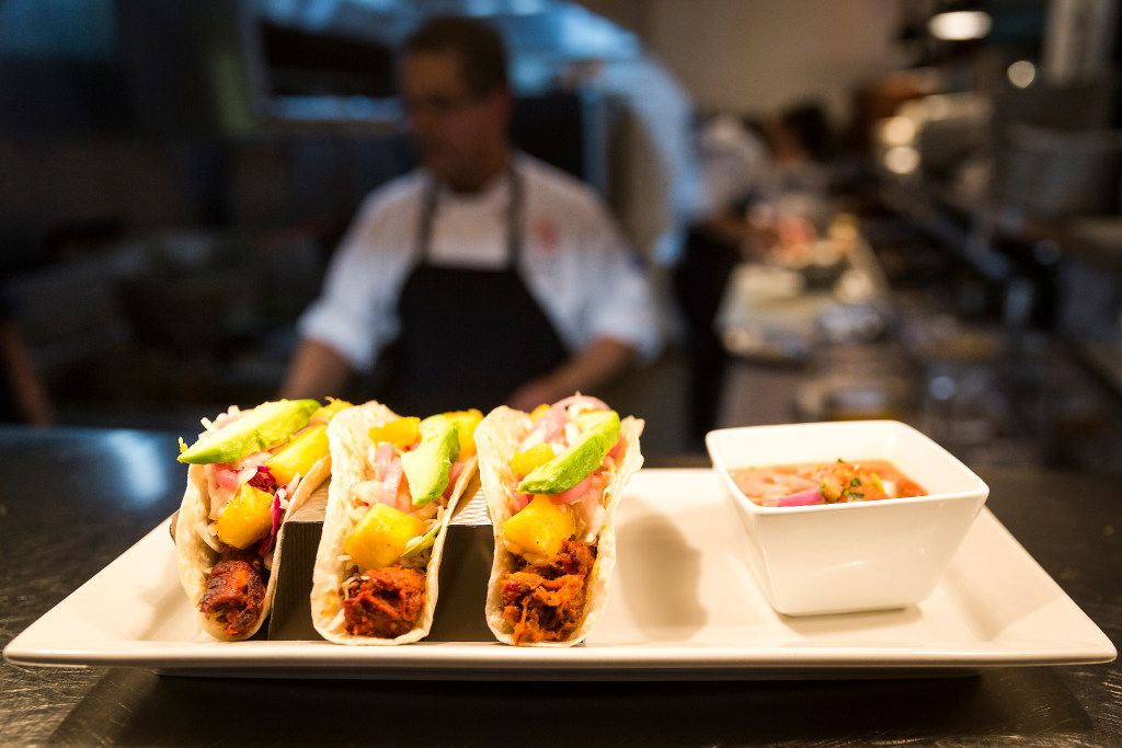 A plate of Al Pastor Tacos waits for delivery to a customer at Beto and Son restaurant in Trinity Groves in West Dallas.