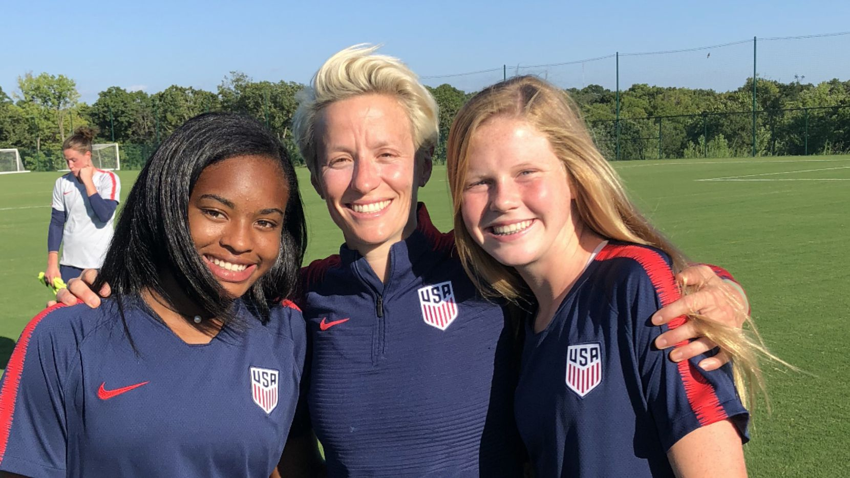 """Shelton's Trinity Byars (left) and Southlake Carroll's Alexis """"Lexi"""" Missimo (right) pose with American soccer star Megan Rapinoe during a U.S. Women's National Team camp in 2018."""