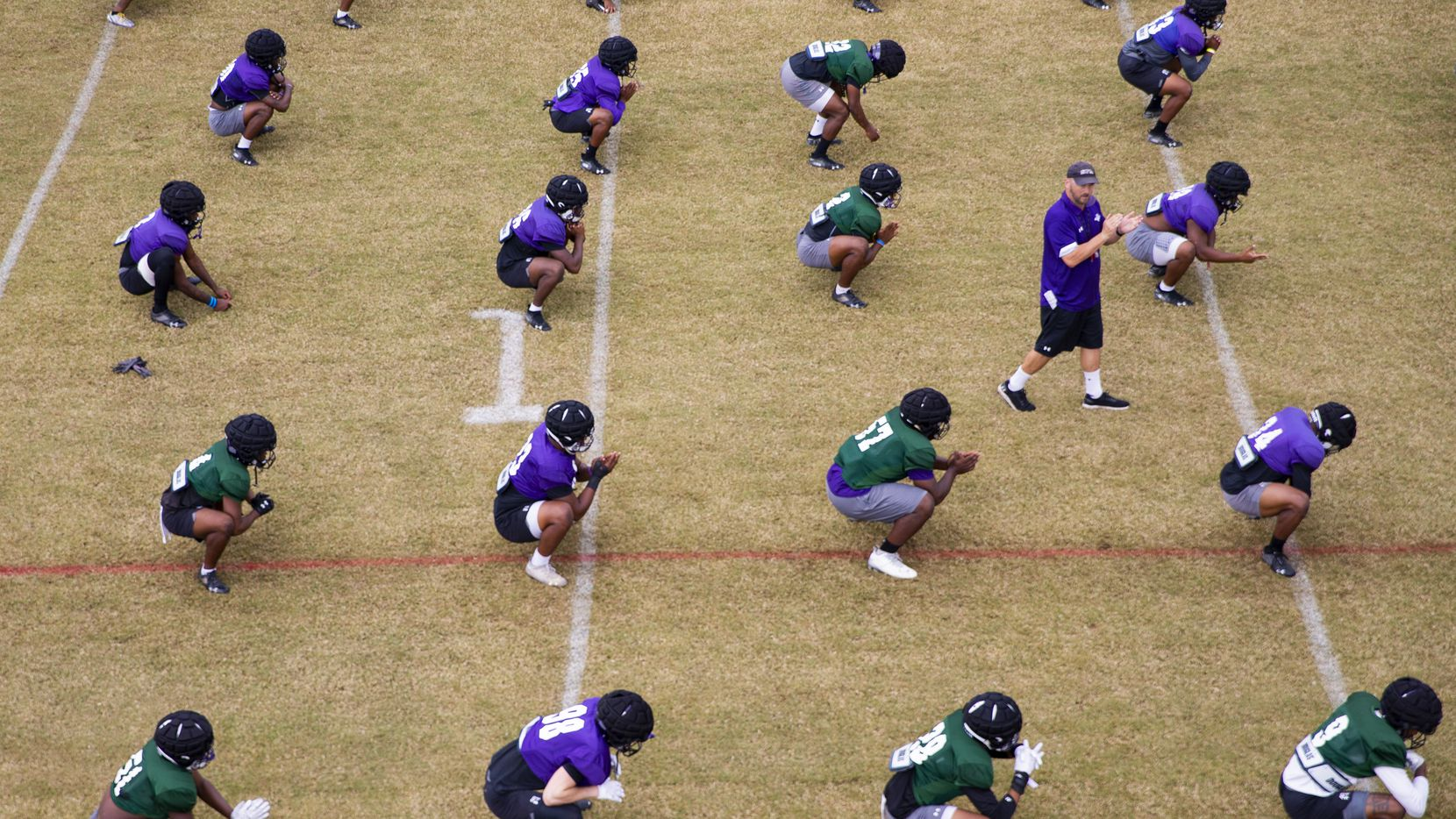 FILE - The SFA football team stretches as coach Colby Carthel leads practice in Nacogdoches on Thursday, Oct. 8, 2020.