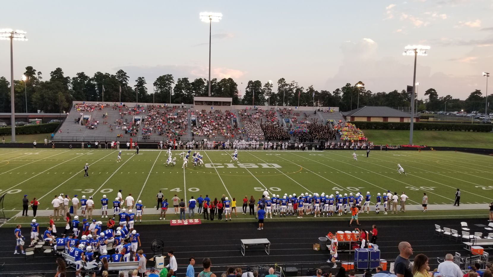 Friday night lights at Buddy Moorhead Stadium in Conroe, Texas, seat of Montgomery County north of Houston. The Woodlands High School beat Oak Ridge 20-14 on Sept. 13, 2019.