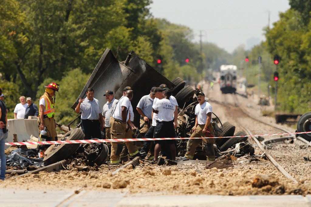 Two people were killed in a dump truck that collided with a Trinity Railway Express passenger train on Calloway Cemetery Road in far East Fort Worth.