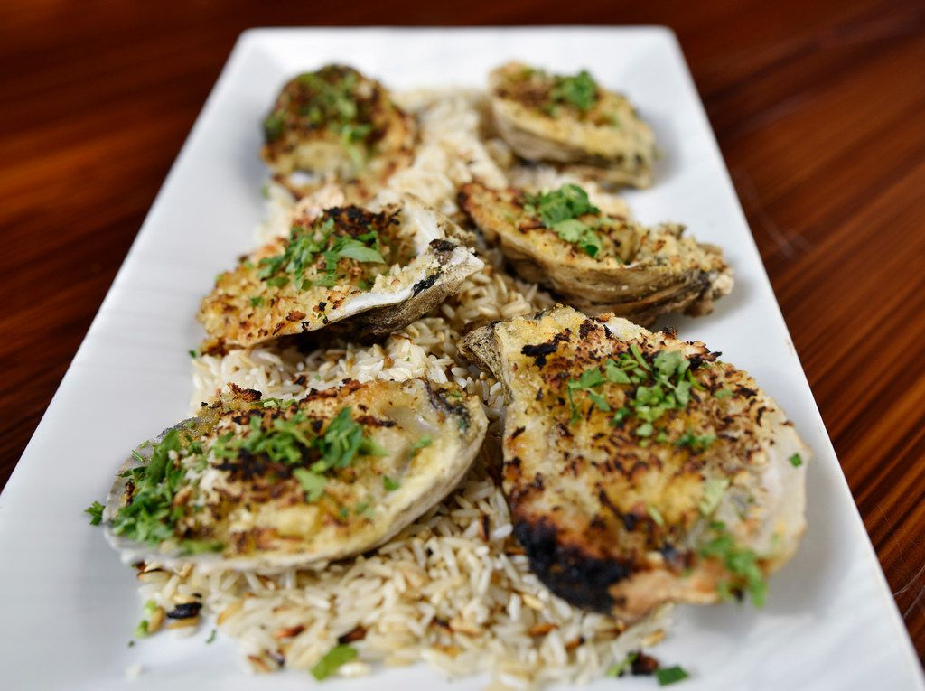 Charbroiled oysters with garlic parmesan from the Crab House seafood and oyster bar in Dallas, Sept. 18, 2019. Ben Torres/Special Contributor