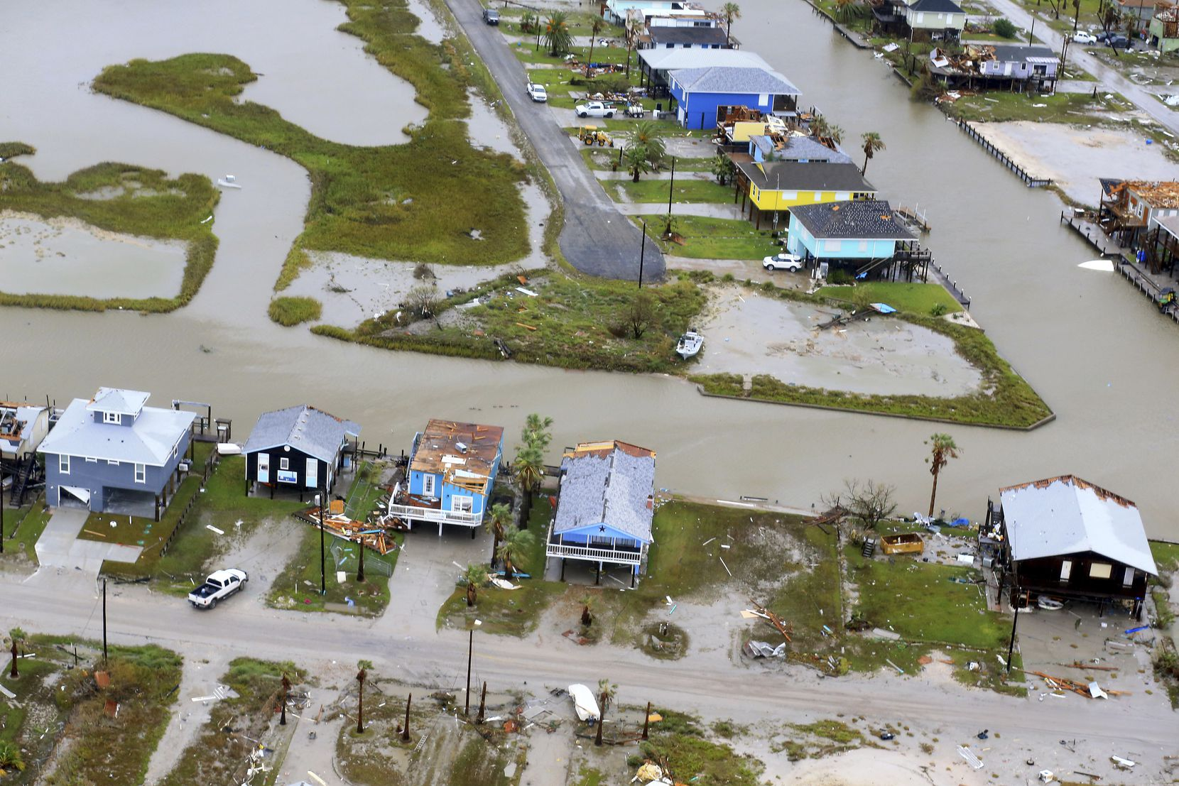 This aerial photo shows damaged homes after Hurricane Harvey, Monday, August 28, 2017, in Corpus Christi, Texas.  Harvey hit the coast as a Category 4 hurricane (Gabe Hernandez / Corpus Christi Caller-Times via AP)