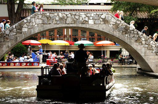 A guided barge trip cruises toward the popular restaurant area along the San Antonio River Walk in downtown San Antonio in a 2007 photo. According to T&L's ranking, city residents ranked perfectly for friendliness.