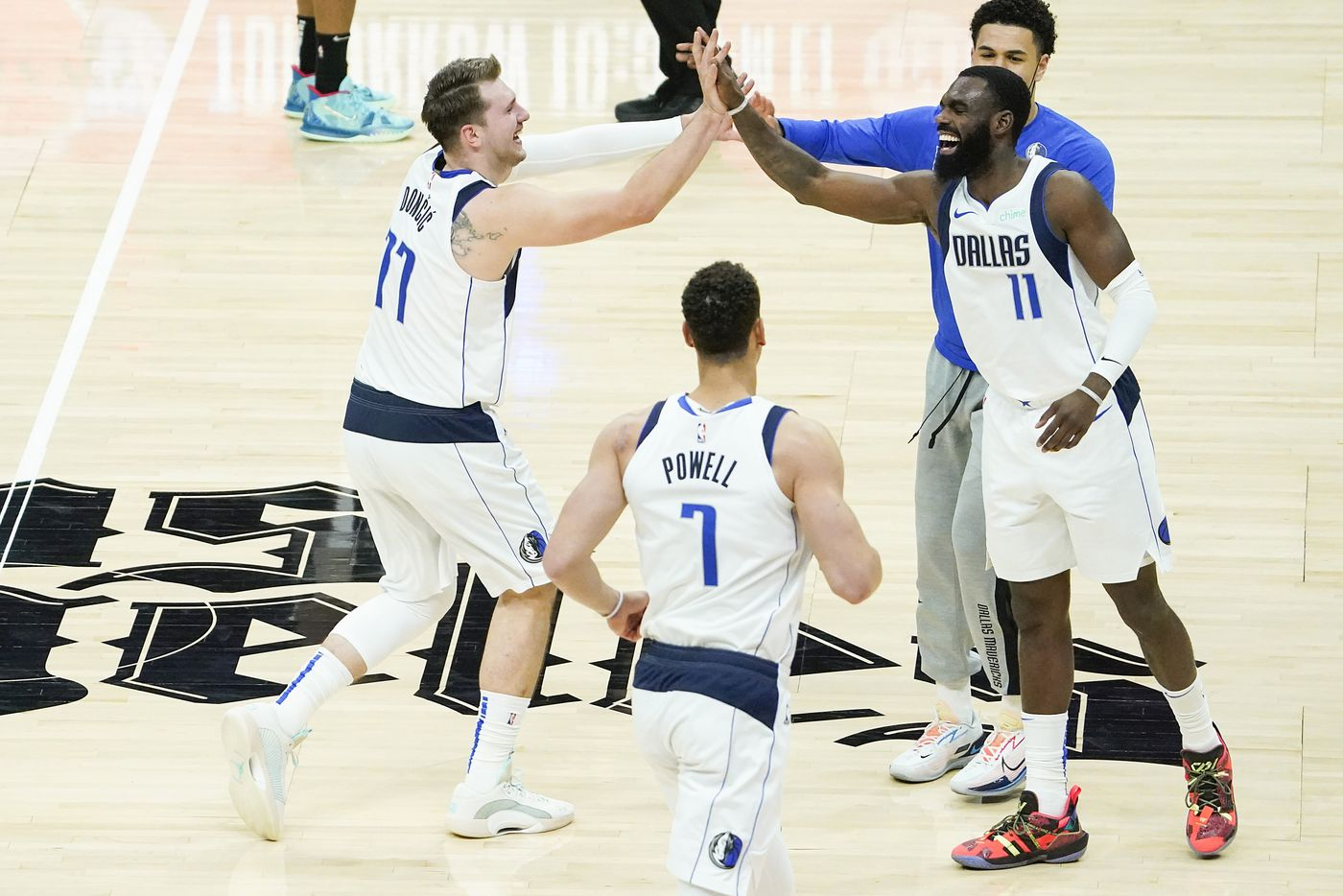 Dallas Mavericks guard Luka Doncic (77) celebrates with forward Tim Hardaway Jr. (11) after scoring during the third quarter of an NBA playoff basketball game against the LA Clippers at the Staples Center on Wednesday, June 2, 2021, in Los Angeles.  (Smiley N. Pool/The Dallas Morning News)