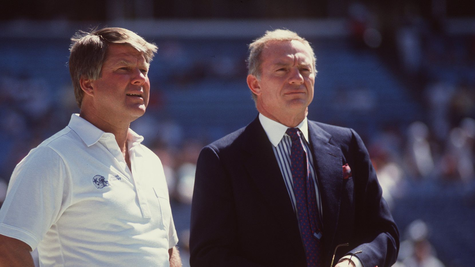 Owner Jerry Jones of the Dallas Cowboys has a conversation with team head coach Jimmy Johnson on the sidelines during pregame warmups before a Cowboys loss to Atlanta in 1990.