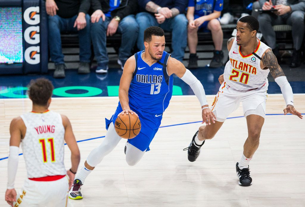 Dallas Mavericks guard Jalen Brunson (13) drives the ball against Atlanta Hawks forward John Collins (20) during the third quarter of an NBA game between the Dallas Mavericks and the Atlanta Hawks on Saturday, February 1, 2020 at American Airlines Center in Dallas.