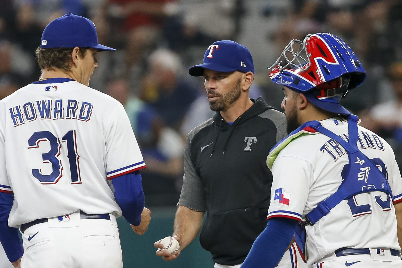 Texas Rangers manager Chris Woodward (8) removes Texas Rangers starting pitcher Spencer Howard (31) from the game during the third inning against the Los Angeles Angels at Globe Life Field on Thursday, Aug. 5, 2021, in Arlington. (Elias Valverde II/The Dallas Morning News)