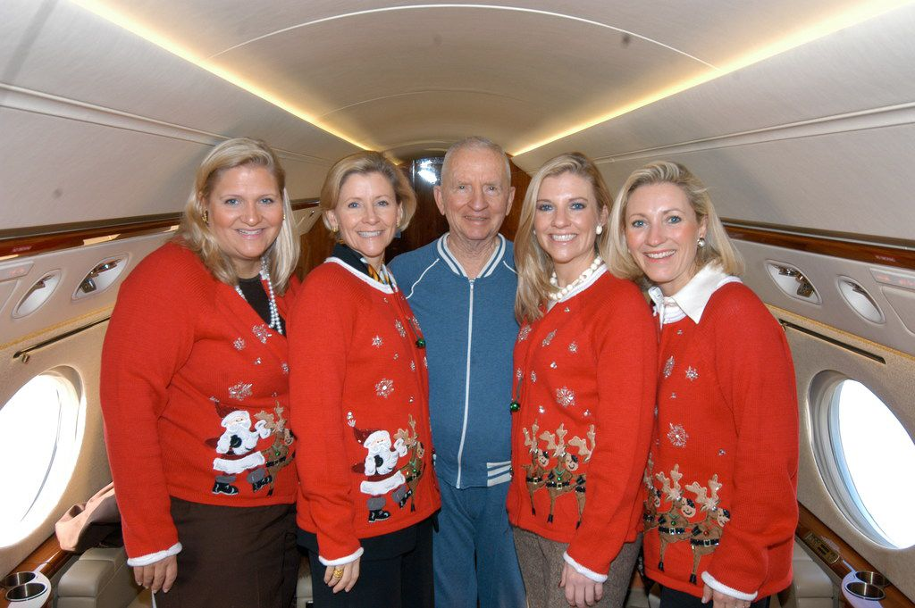 Ross Perot is surrounded by daughters (from left) Suzanne McGee, Nancy Perot, Katherine Reeves and Carolyn Rathjen wearing light-up Christmas sweaters that their dad bought at Dougherty's Pharmacy in 2007.