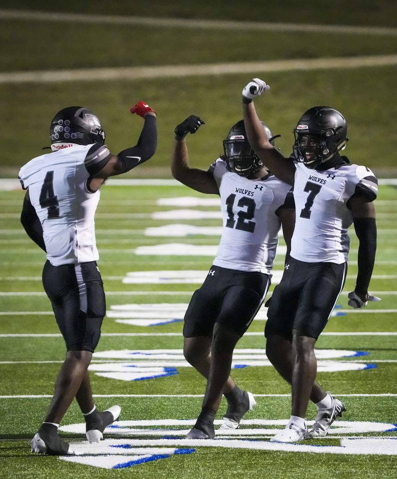Mansfield Timberview's Jonathan Smith (4) celebrates a defensive play with teammates Joel Ardern (12) and Landon Hullaby (7) during the first half against Waco University in a high school football game at Waco ISD Stadium on Friday, Oct. 8, 2021, in Waco, Texas.